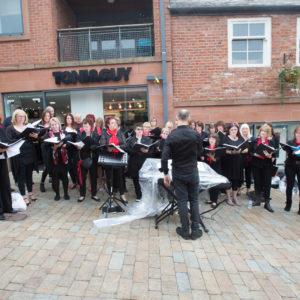 The Magic Voices Choir performing on Regent Street, KMF 2017